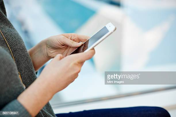 A woman holding a smart phone.