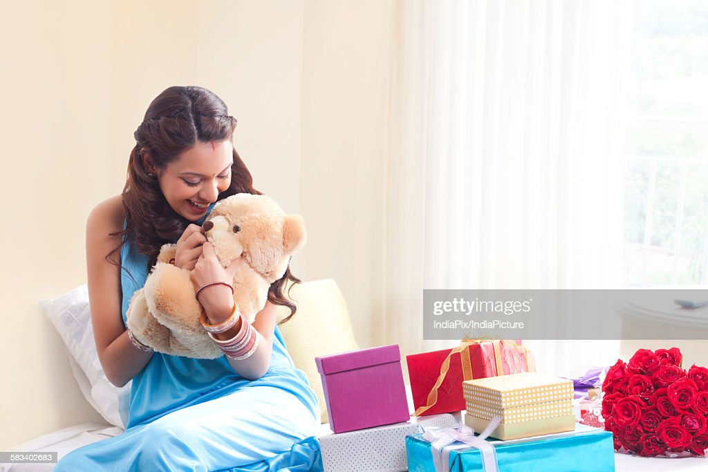Woman holding a teddy bear : Stock Photo