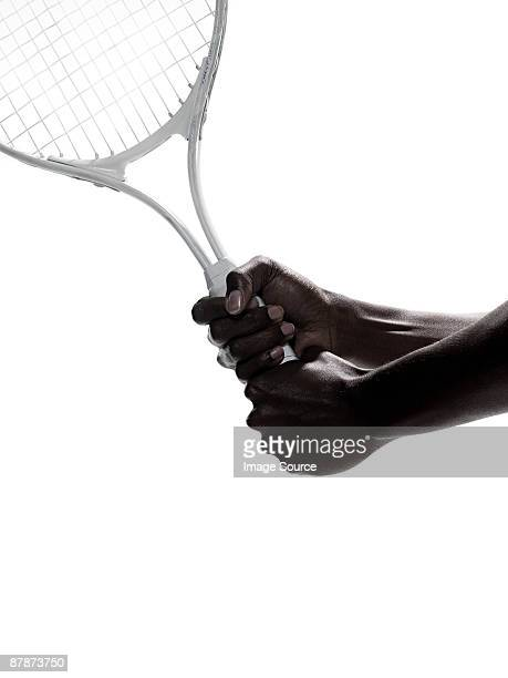 A woman holding a tennis racket