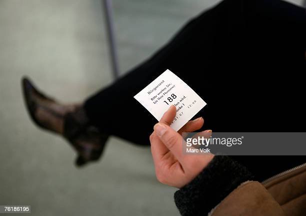 A woman holding a ticket in a waiting room