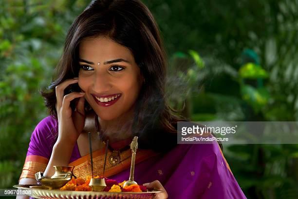 woman holding a tray - mangala sutra fotografías e imágenes de stock