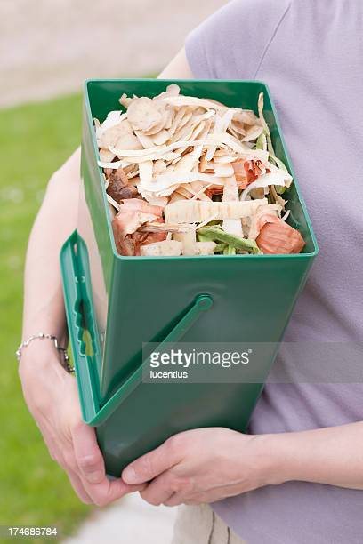 Woman holding a vegetable recycle bin