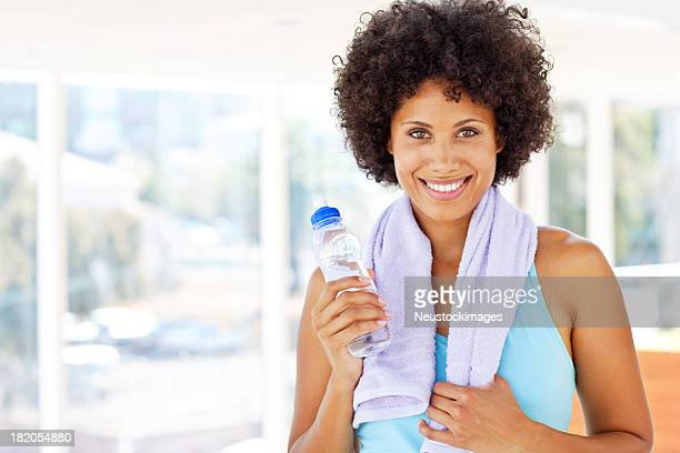 Woman Holding a Water Bottle After Her Workout