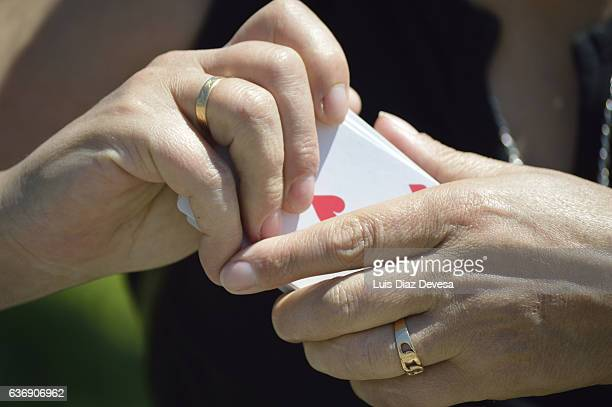 woman holding ace of hearts