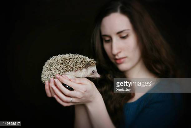 Woman holding African Pygmy hedgehog
