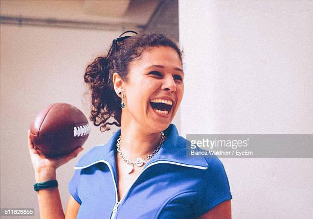 Woman holding an American football