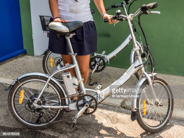 Woman holding an electric bicycle