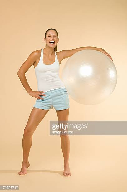 woman holding an exercise ball - caucasian appearance stock pictures, royalty-free photos & images