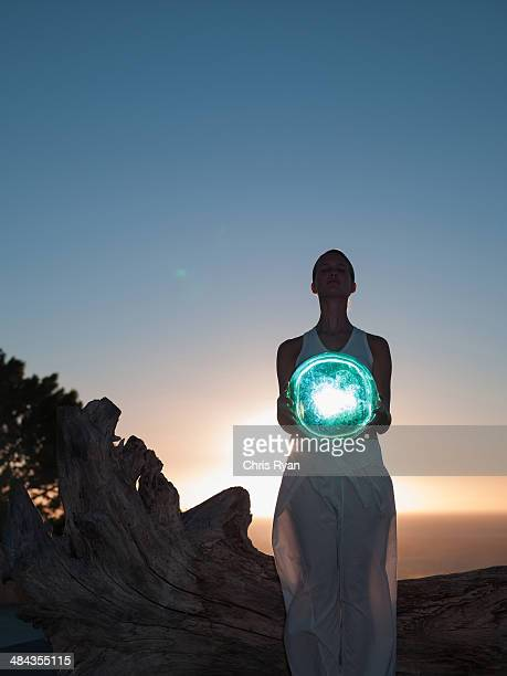 woman holding an orb - illusion stock pictures, royalty-free photos & images
