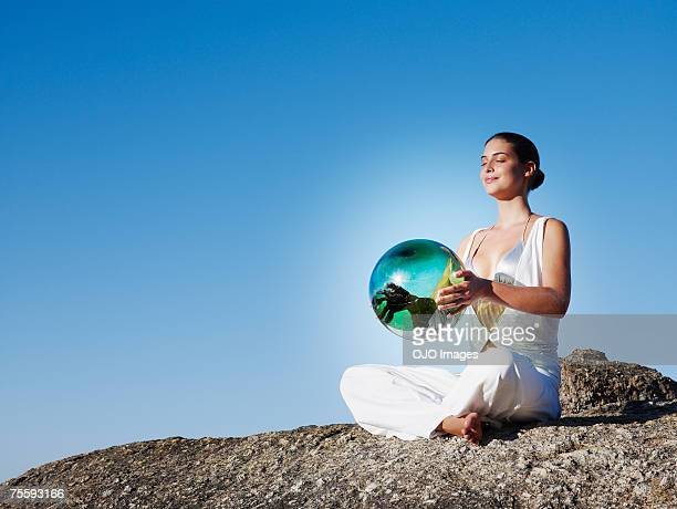 a woman holding an orb - fate stock photos and pictures