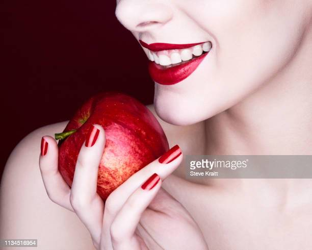 woman holding apple - beautiful woman stock pictures, royalty-free photos & images