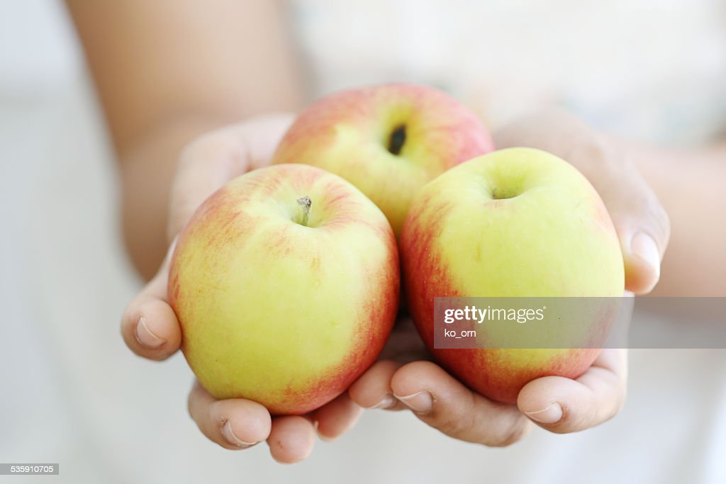 Woman holding apple. : Stock Photo
