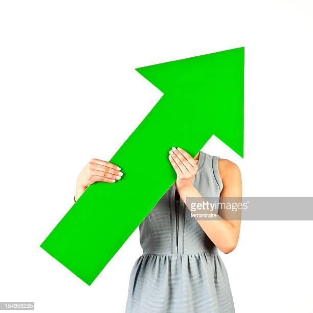 Woman holding arrow pointing up