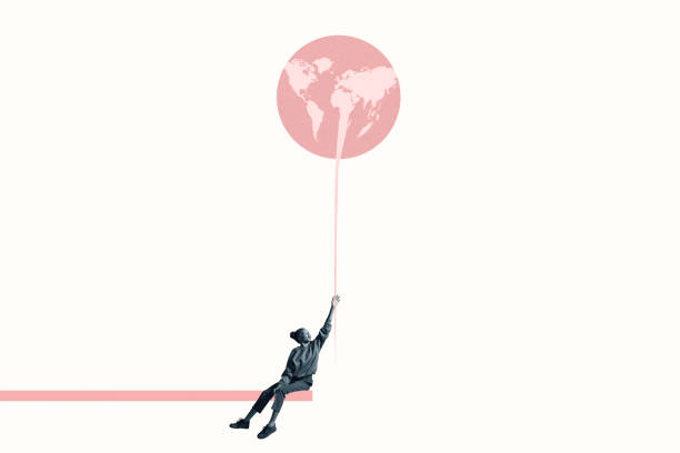 Woman holding at large pink balloon with world map