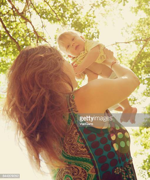 woman holding baby boy - vladgans or gansovsky stock pictures, royalty-free photos & images