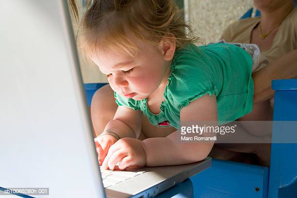 woman holding baby girl (9-12 months) at laptop - 12 23 months stock pictures, royalty-free photos & images