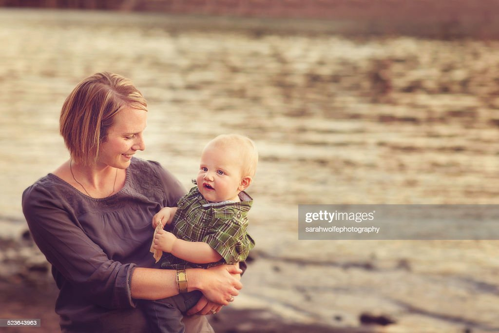 Woman Holding Baby On Hip