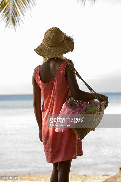 woman holding bag of clothes - woman carrying tote bag stock photos and pictures