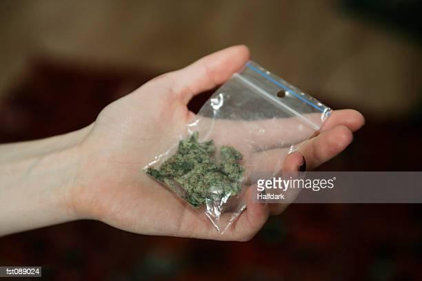 Woman holding bag of marijuana
