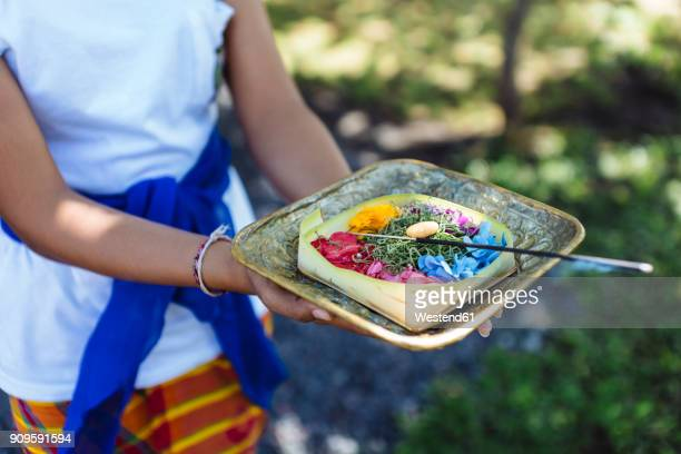 woman holding balinese offering - balinese culture stock pictures, royalty-free photos & images