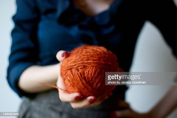 Woman holding ball of yarn
