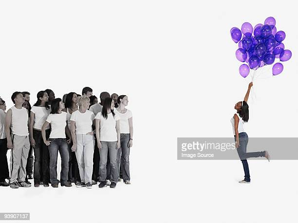 woman holding balloons - isolated color stock pictures, royalty-free photos & images