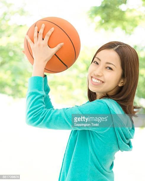 Woman Holding Basketball