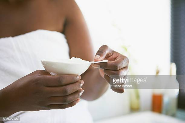 woman holding bath salts - fat women in bath stock pictures, royalty-free photos & images