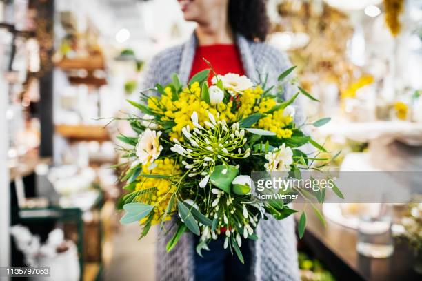 Woman Holding Beautiful Bouquet Of Flowers