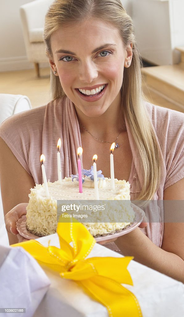 A naked woman holding a birthday cake — pic 12