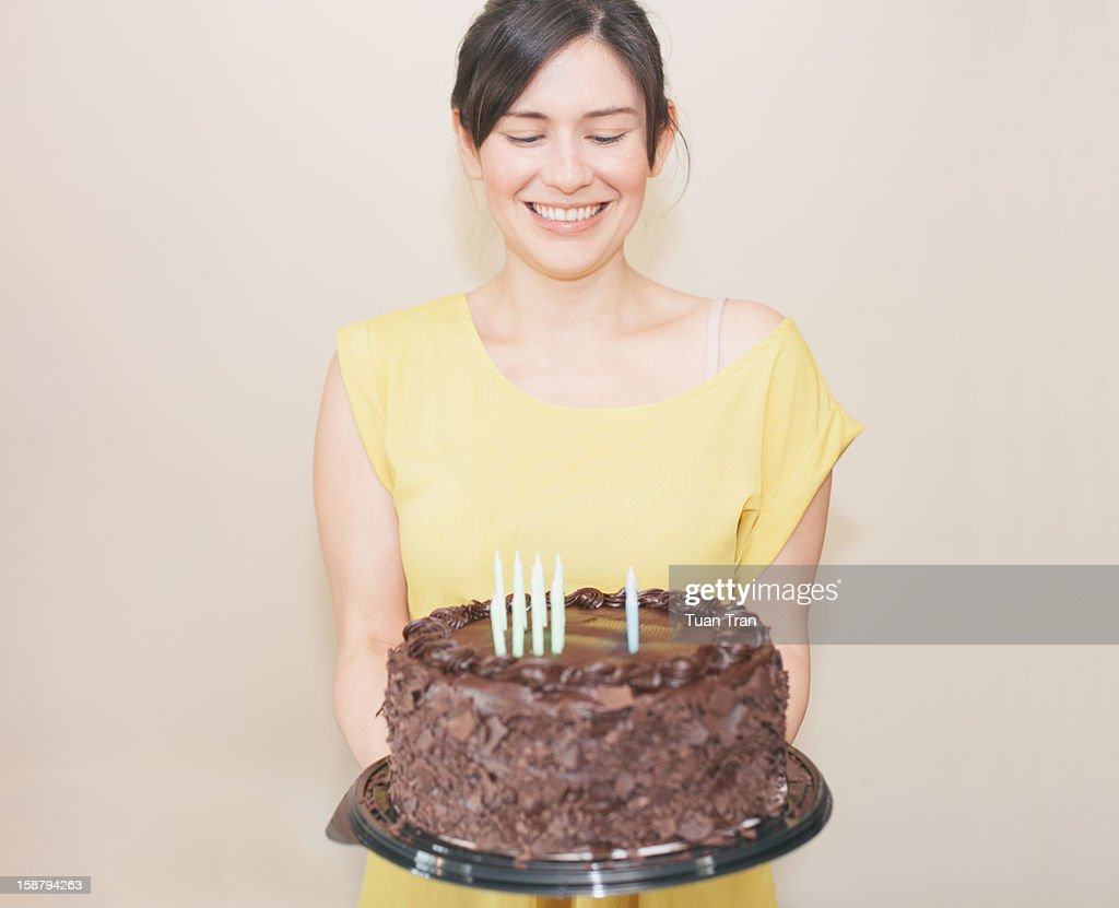 Woman holding birthday cake : Stock Photo