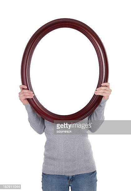 woman holding blank frame - mirror object stock pictures, royalty-free photos & images