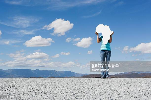 Woman holding blank map of Africa