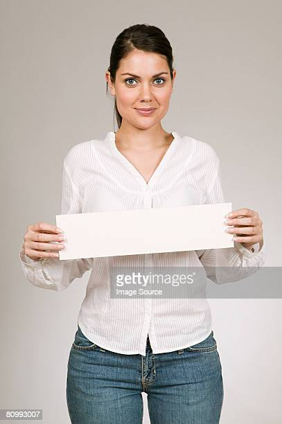 woman holding blank sign - person holding blank sign stock pictures, royalty-free photos & images
