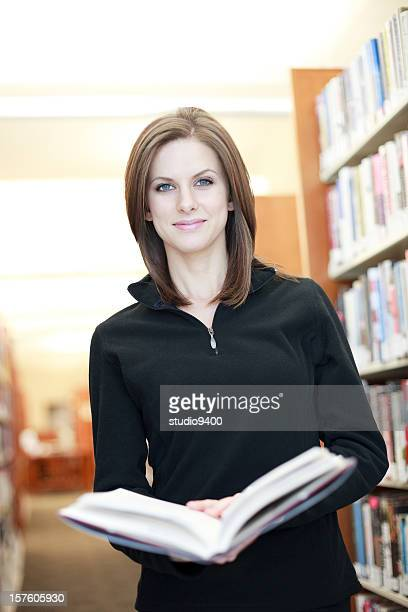 Woman holding book at Library