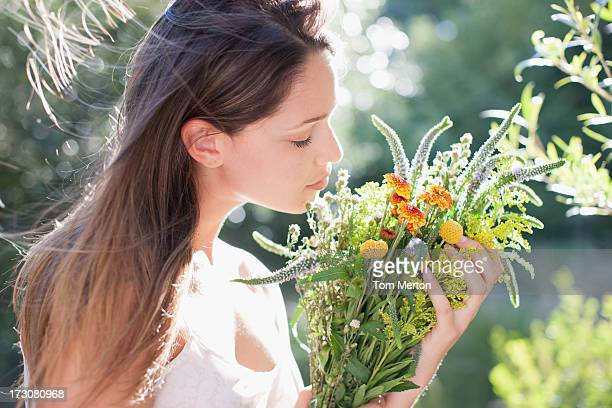 woman holding bouquet of flowers - scented stock pictures, royalty-free photos & images