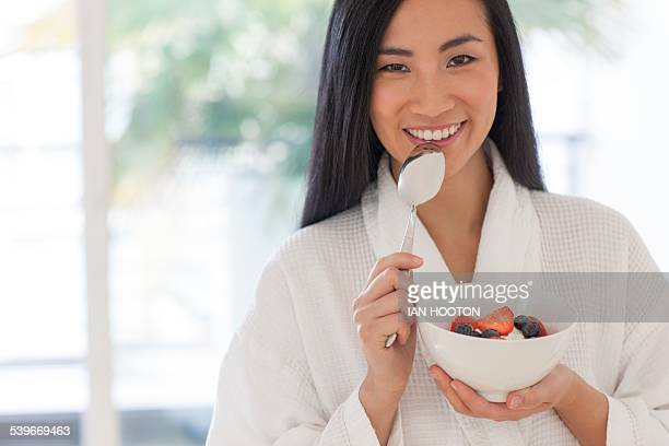 Woman holding bowl of fruit