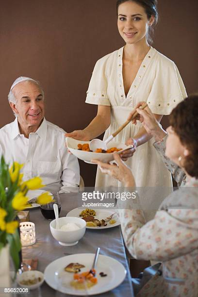 woman holding bowl of vegetables - judaism stock pictures, royalty-free photos & images
