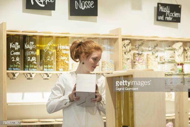 Woman holding box in shop
