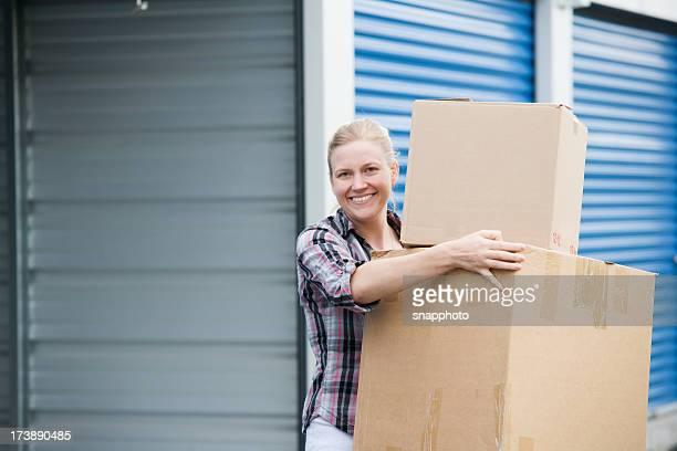 Woman Holding Boxes Outside Self Storage Unit