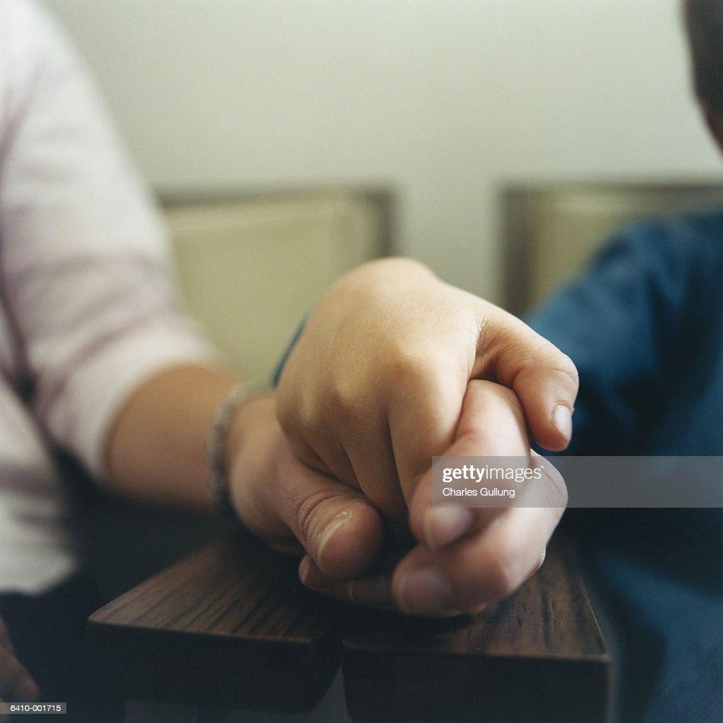 Woman Holding Boy's Hand : Stock Photo