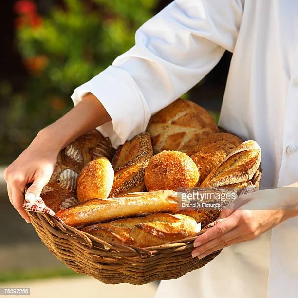 Woman holding breadbasket