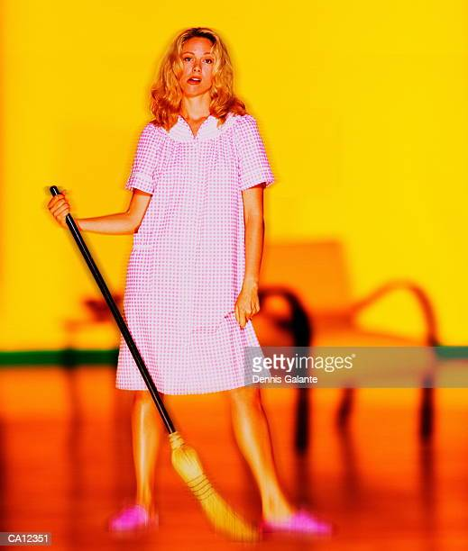 Woman holding broom, portrait (digital enhancement)