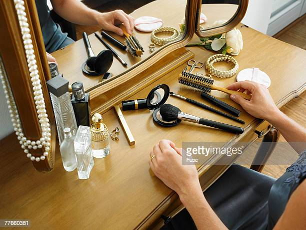 Woman Holding Brush at Dressing Table