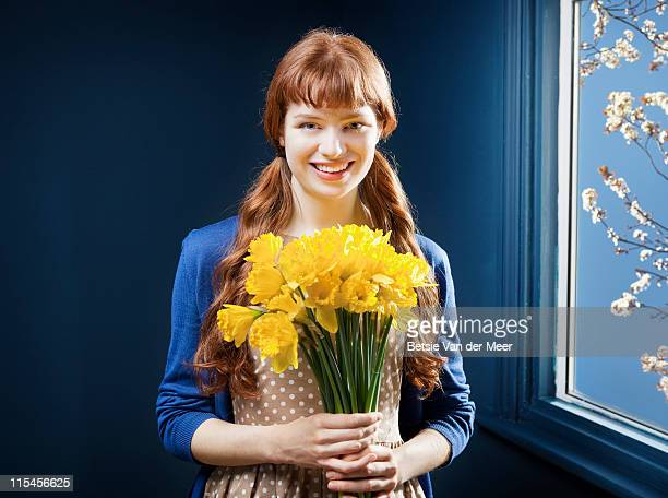 woman holding bunch of daffodils. - daffodils stock pictures, royalty-free photos & images