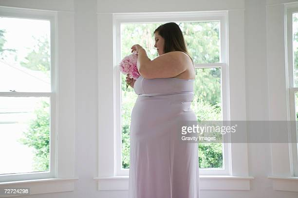 woman holding bunch of flowers, profile - bridesmaid stock pictures, royalty-free photos & images