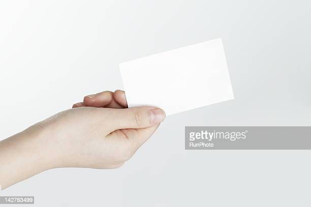 Woman holding business card,hand close-up