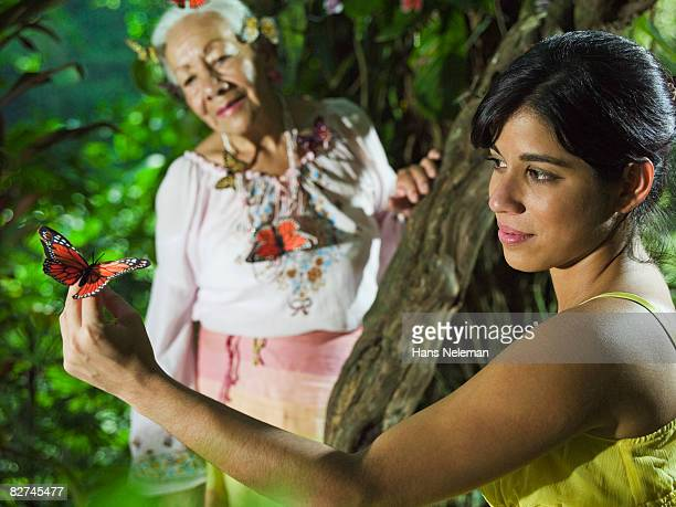 woman holding butterfly, mother nature - las posas stock pictures, royalty-free photos & images