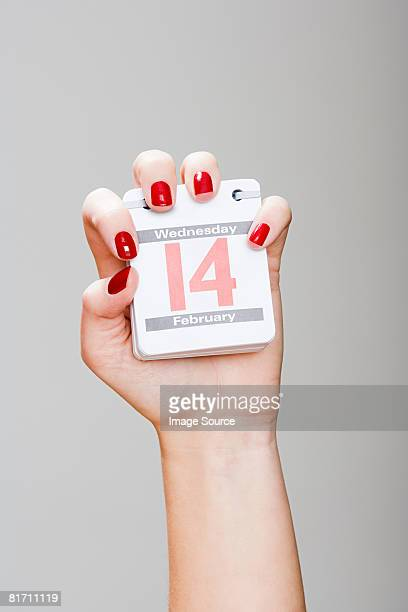 Woman holding calendar on valentines day