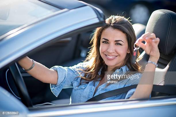 Woman holding car keys